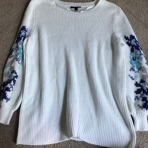 Sweater with blue snow flakes on the sleeves